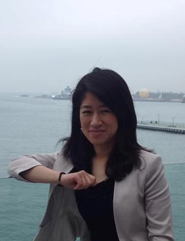 Shu Zhang providing English to Chinese translations and interpreting services